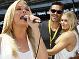 Revving up! LeAnn Rimes holds husband Eddie close before taking to the stage to perform National Anthem at 2014 Indy 500
