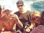 Ready to mingle: Newly single Gigi Hadid is spotted hanging out with a shirtless Justin Bieber on a yacht off the coast of France