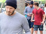 Health and fitness: David Beckham gave a hint as to how he stays in such good shape as he and his son Romeo stepped out in gymwear and grabbed fruit to go