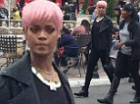 Now THAT'S a good disguise! Rihanna sports short pink wig... and miraculously manages to blend in with the crowd at the mall