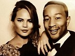 Inside the party! John Legend tweeted a photo booth snap of him and Chrissy Teigen with the caption 'Love, love, love'
