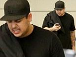 Rob Kardashian skips Kim's wedding and flies back to LA after dubbing it 'superficial bulls***'