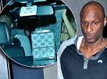 Lamar Odom looks glum as he leaves L.A. club with mystery woman as Khloe Kardashian enjoys her sister's sumptuous wedding celebrations in Europe