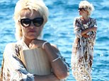 She comes bearing gifts! Pamela Anderson is ready to the high seas in stunning bikini style
