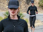 Nipping out for a run! Nicole Kidman, 46, shows more than she might've wanted as she jogs in tight-fitting jacket