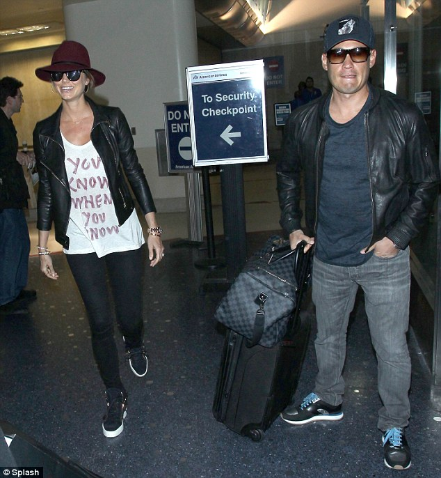 Trying to send a message? The couple arrived in LAX in April, with Stacy wearing a shirt stating, 'You know when you know'