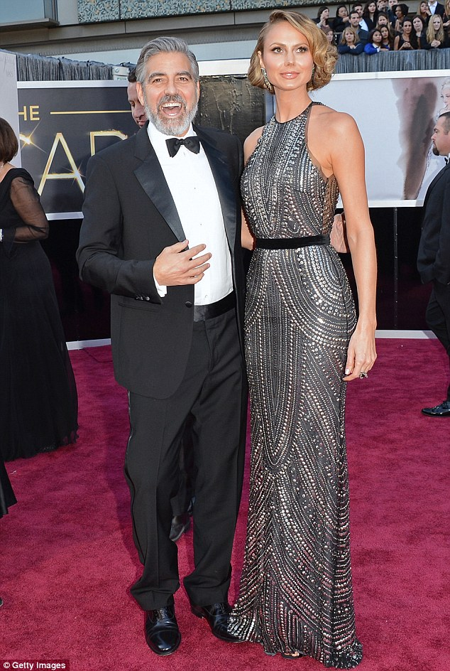 Back in the day: Stacy split from George Clooney last June after two years of dating, pictured together at the Oscars last February