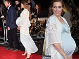 Baby bump: Guy Ritchie's fiancee Jacqui Ainsley looked glowing as she dressed her baby bump to perfection in a long flowing sky blue dress