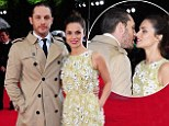 Sneaky smooch: Tom Hardy and his fiancée Charlotte Riley still looked to be in the early throes of love as they puckered up for a smooch on the red carpet at the world premiere of Edge Of Tomorrow at the IMAX cinema in London on Wednesday morning