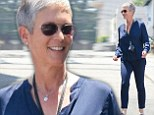 Silver fox: Actress Jamie Lee Curtis, 55, appeared to be in a great mood as she talked and laughed with a fellow gray-haired friend as they made their way to lunch in West Hollywood on Tuesday