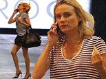 Diane Kruger distracts from make-up free face by showing off slim pins in black shorts and spotty stilettos for lunch with pals