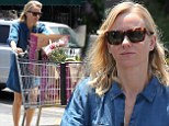 Legs on show: Naomi Watts hit the streets in LA wearing s short denim dress