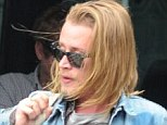 Back with a bang: Macaulay Culkin showed his resilience as he stepped off his tour bus in Birmingham ahead of another Pizza Underground gig shortly after getting booed off stage