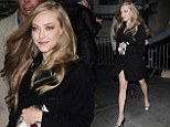 Amanda Seyfried shows off her lustrous curls and puts her slim pins on display as she made her way to radio appearance