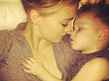 Mother son bonding: Hilary Duff shared an adorable photo cuddling with her son Luca on Monday, writing, 'This is everything'