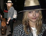 Chloe Moretz showcases her Kick-Ass style in houndstooth jacket and trilby as she touches down at LAX