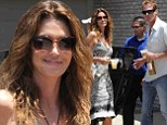 Getting the party started! Cindy Crawford and Rande Gerber each clutch a bottle of tequila at Memorial Day bash