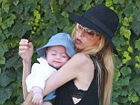 Content: Rachel Zoe was seen cradling her very content and slumbering son Kaius in Malibu on Monday