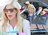 Reality show must be paying off! Tori Spelling was seen with a shopping cart full of purchases as she left Toys R Us in Los Angeles, California on Monday
