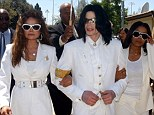 Kidnap plan: Michael, seen here with sisters LaToya and Janet in August 2004, was going to be kidnapped from Bahrain by his manager and taken to a rehabilitation center in 2006
