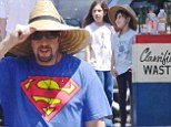 Dad to the rescue! Adam Sandler dons Superman T-shirt as he helps his daughters Sadie and Sunny sell lemonade