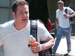 Chaz Bono looks slimmer than ever as he visits a friend in white T-Shirt and pale blue chinos