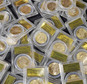 FILE - This Feb. 25, 2014 file photo shows some of the 1,427 Gold-Rush era U.S. gold coins displayed at Professional Coin Grading Service in Santa Ana, Calif...