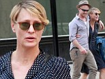 Dotty for you! Robin Wright dons blue spotted frock as she enjoys romantic stroll with toyboy fiance Ben Foster