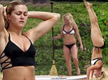 Witney Carson does headstands in Hawaii before a bikini paddleboarding session with DWTS co-star Lindsay Arnold