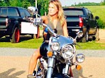 Ready to ride: Carrie Underwood shared a photo via Twitter showing herself on a brand new motorcycle given to her by Miranda Lambert