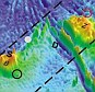 A new seafloor topography of the Malaysia Airlines flight MH370 search area has been released (pictured). Dashed lines approximate the search zone for sonar pings emitted by the flight data recorder and cockpit voice recorder popularly called black boxes. The first sonar contact (black circle) was made by a Chinese vessel