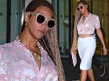 Beyonce is business chic in blouse and pencil skirt while sucking on a lollipop as she gets back to work following Hamptons getaway