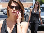 Ashley Greene displays her incredibly toned arms in a sleeveless blouse as she treats herself to a manicure on rare day off