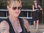 Branded for life! Melanie Griffith shows off love for her husband Antonio Banderas with heart tattoo