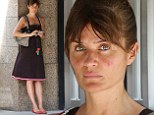 Looking homely:The 45-year-old supermodel Helena Christensen ditched her usually stylish presence for a simple ensemble, messy hair, and zero makeup on her sunburnt face