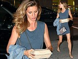 A different kind of superfood: Supermodel Gisele spotted walking in a thigh skimming navy dress carrying take-away in New York