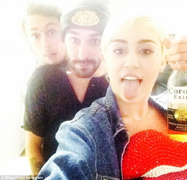 Turn up! The blonde beauty stuck her tongue out and held a bottle of Corona with two friends in a photo shared on Monday