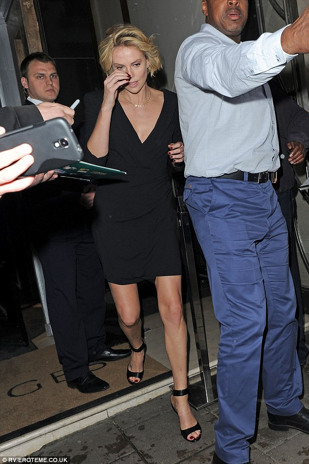 Looking good: Charlize Theron looked stunning as she left London's Claridges hotel on Monday night along with her partner Sean Penn and her two-year-old son Jackson