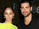 Not engaged: He likes it, but Jesse Metcalfe hasn't put a ring on girlfriend Cara Santana yet, pictured at the LA Jaguar launch earlier this month