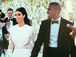 Just Married! Kim and Kanye walk down the aisle in front of their nearest and dearest moments after saying 'I do'