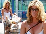 Letting it hang loose! Frizzy-haired Rachel Hunter lugs around shopping after hitting Farmer's Market sans bra