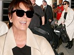 Doting grandma: Kris Jenner pushed baby North in a stroller as she flew into LAX on Monday