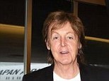 Unwell: Sir Paul McCartney has been hospitalized with a virus in Tokyo - seen here arriving at Haneda airport on May 15