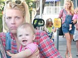 Family fun! A makeup-free Busy Philipps treats her adorable daughters to a cafe breakfast
