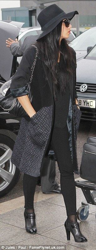 On their way: Scherzinger looked stylish in her airport outfit as they made their way to Heathrow Airport