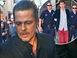 Violent scuffle as Brad Pitt is targeted by serial red carpet prankster Vitalii Sediuk at Maleficent premiere