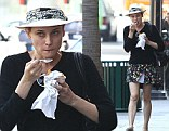 Cool as ice: Diane Kruger makes snacking look stylish as she tucks into frozen yogurt dressed in floral skirt and trilby whilst shopping in LA