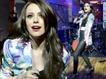 Nothing will stop her dancing! Cher Lloyd flashes toned midriff in tight leather skinnies and colourful blazer as she performs at MLB Fan Cave