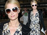 Jet setting: Paris Hilton was happy to be home as she landed in LAX on Thursday, tweeting 'Finally just landed back in LA. Feels like I've been gone forever. Can't wait to get home to my pets! #HomeSweetHome'