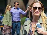 Shopping trip: Molly Sims carried a bag on Thursday after shopping with husband Scott Stuber in New York City